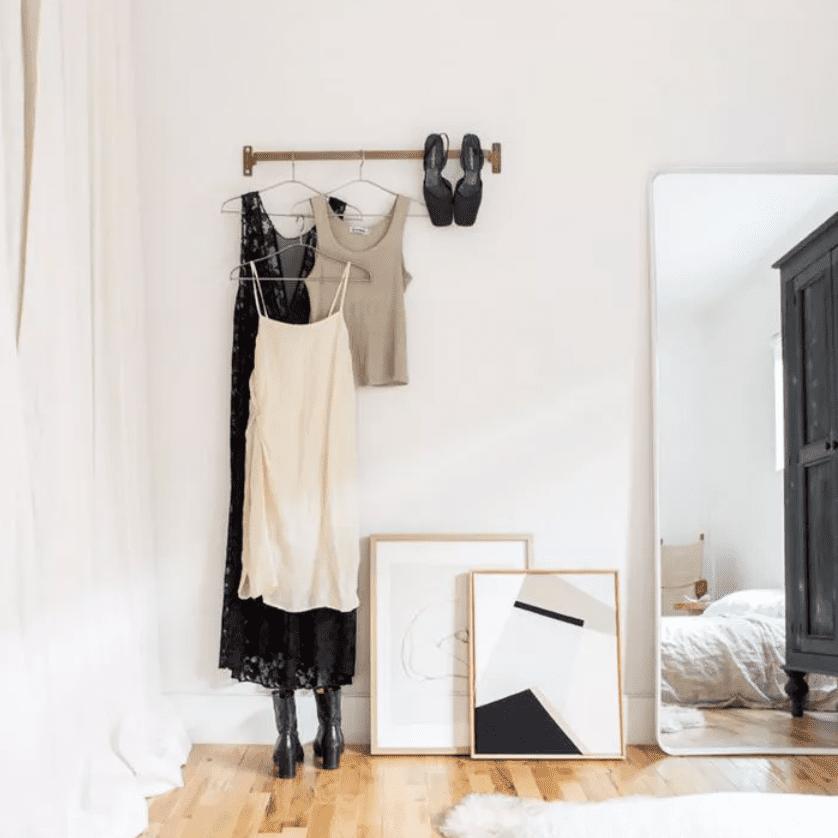 Art leans against wall, set on floor