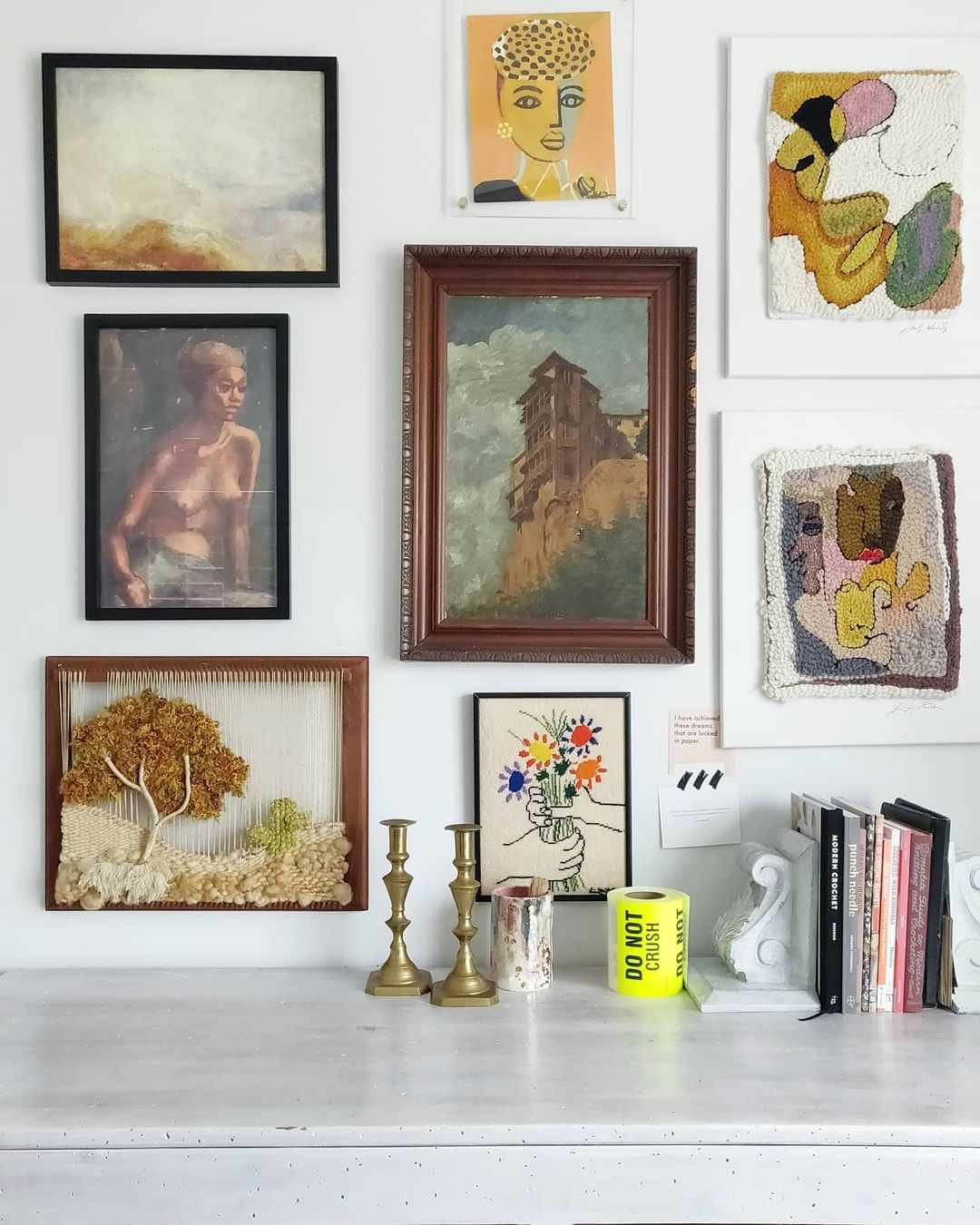 Vintage art hung on a gallery wall.