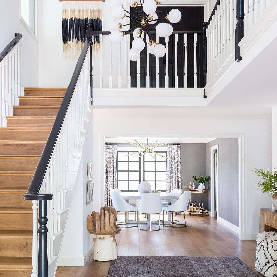 Staircase with contrasting stairs and bannister.