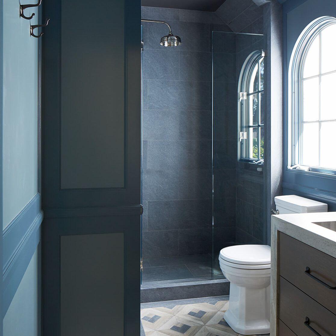 Traditional meets modern, blue-tiled bathroom