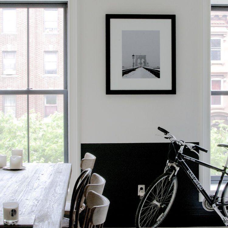 minimalist black and white kitchen with bike