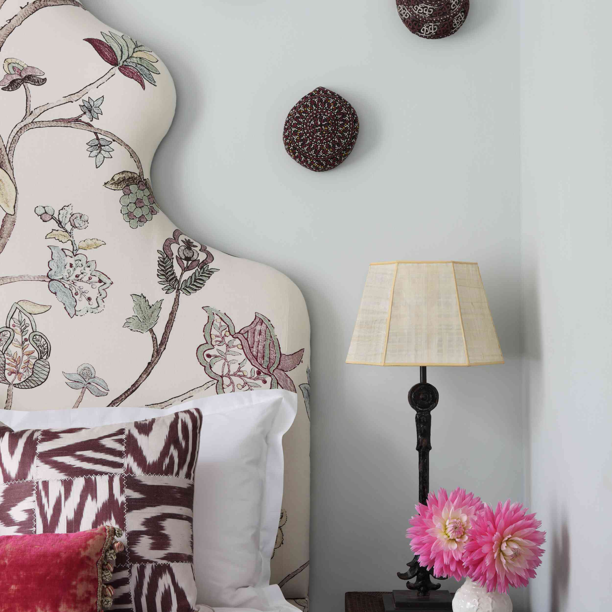 A maximalist bedroom with light blue walls