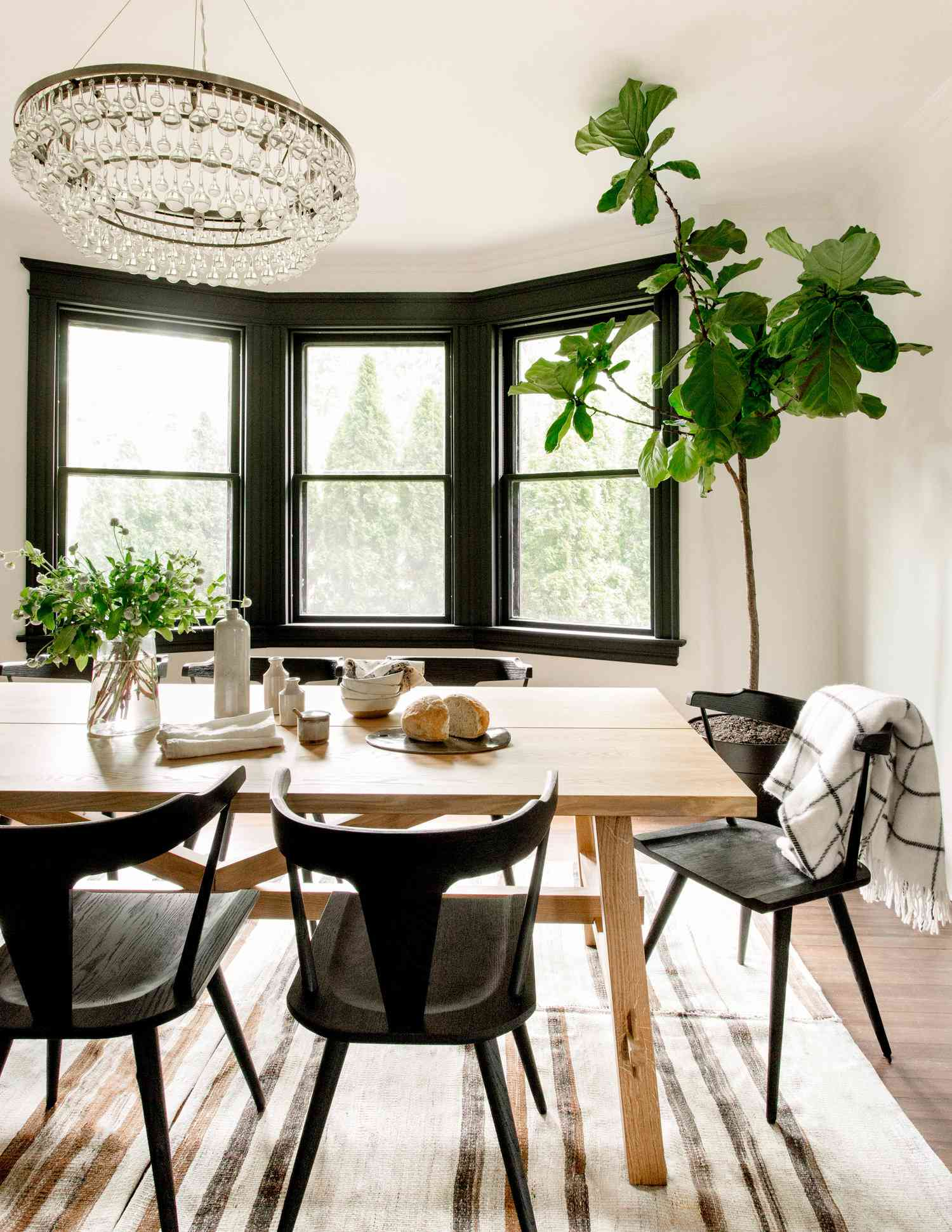 A dining room, featuring window trim that's been painted black
