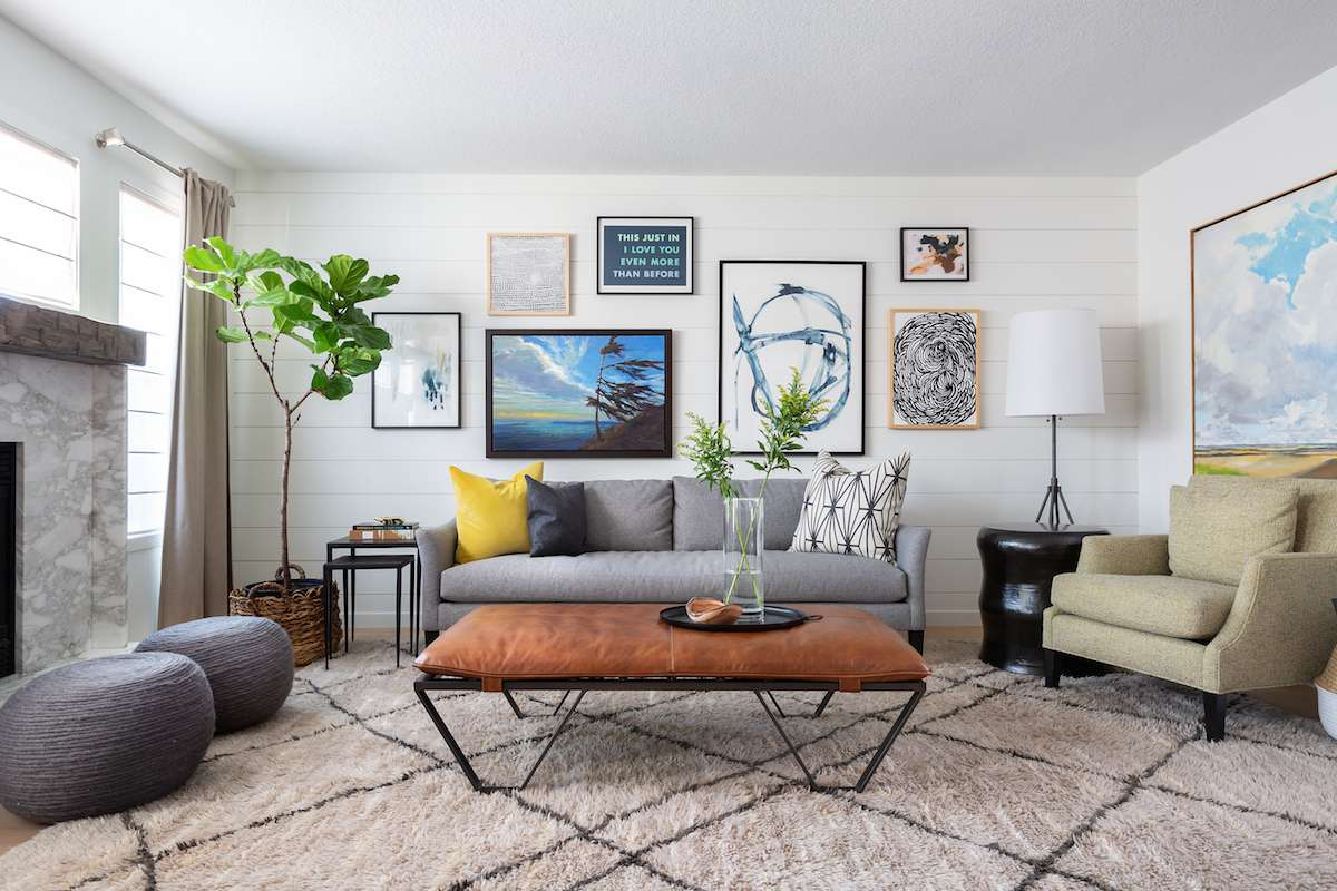 Living room with gallery wall behind the couch