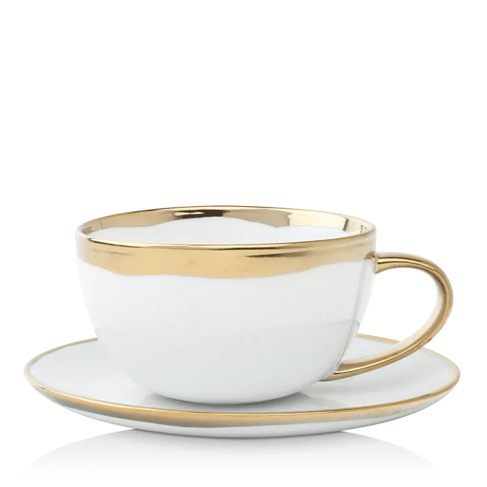 White cup and saucer set with gold trim.