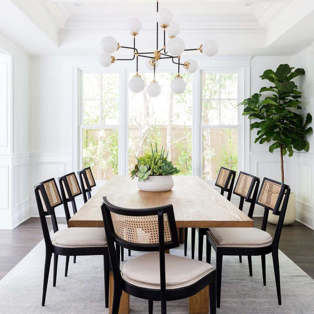 Modern dining room with black cane chairs