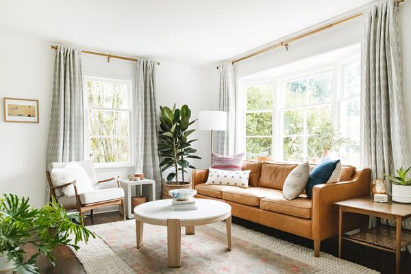 bright living room with tan leather sofa