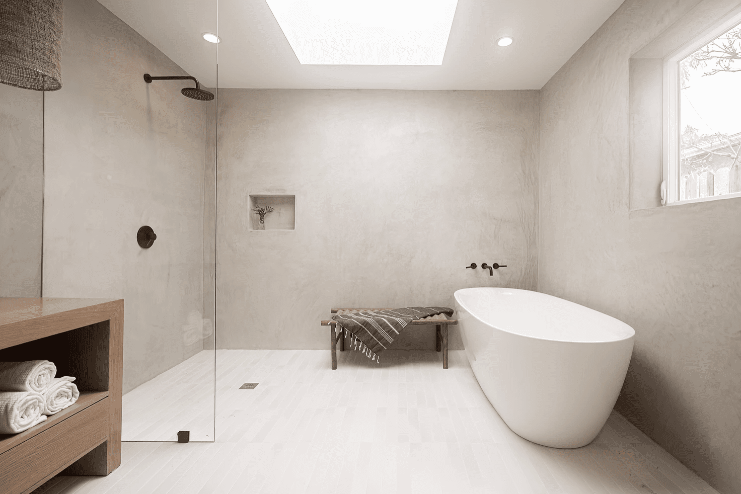 A cement-lined master bathroom