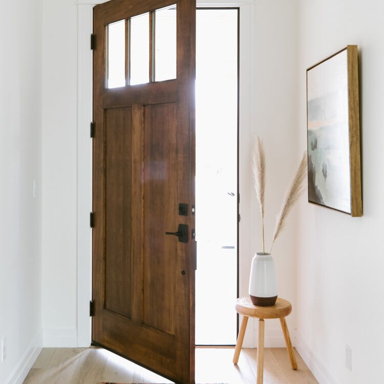 Boho chic styled entryway with a vintage rug and pampas grass decor