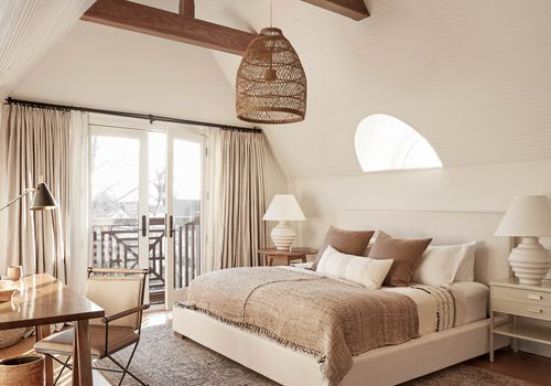 A bedroom filled with almond decor from floor-to-ceiling