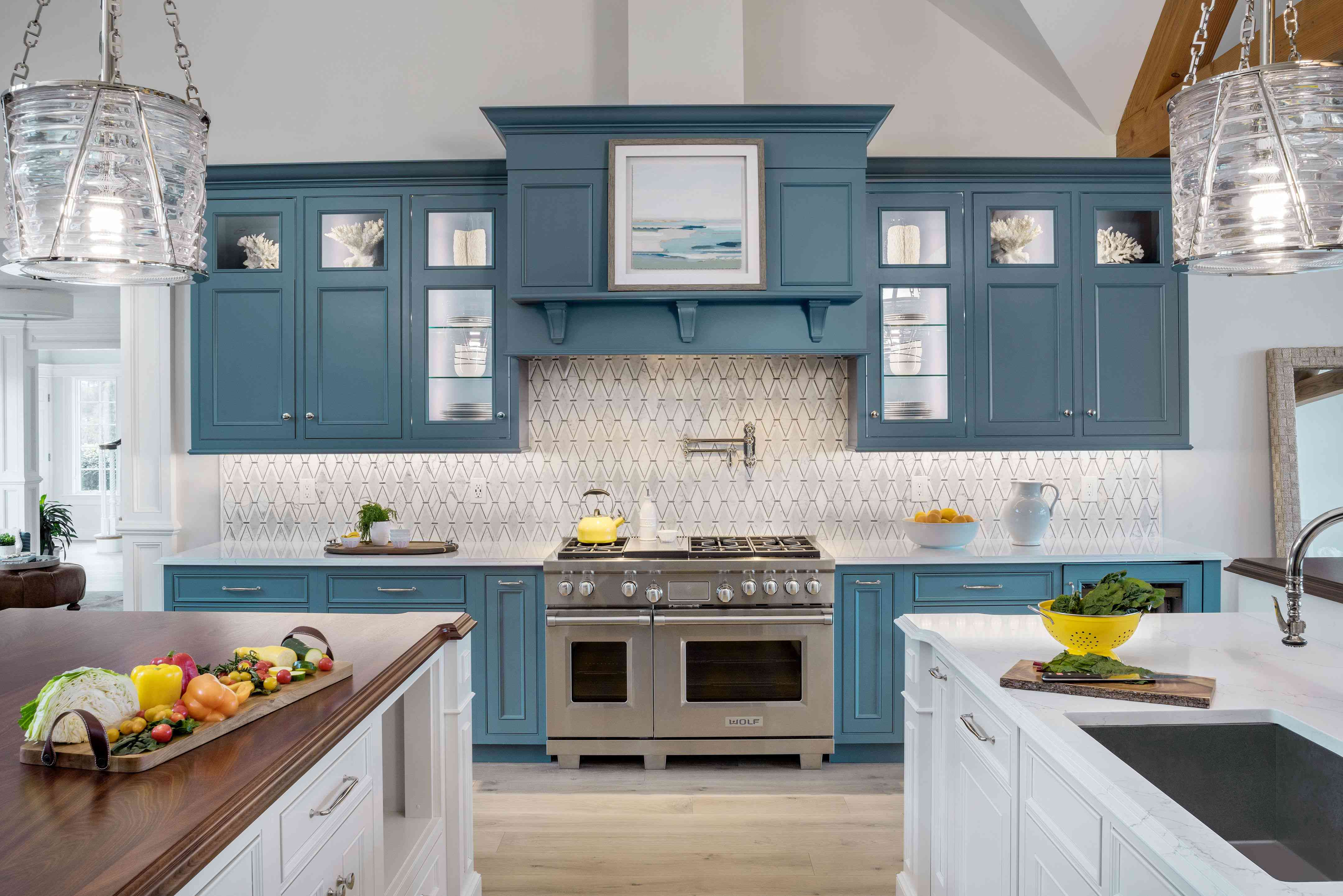 ocean meadow kitchen, muted blue cabinets, white patterned backsplash, white countertops