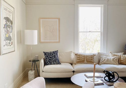 Apartment living room with white couch.