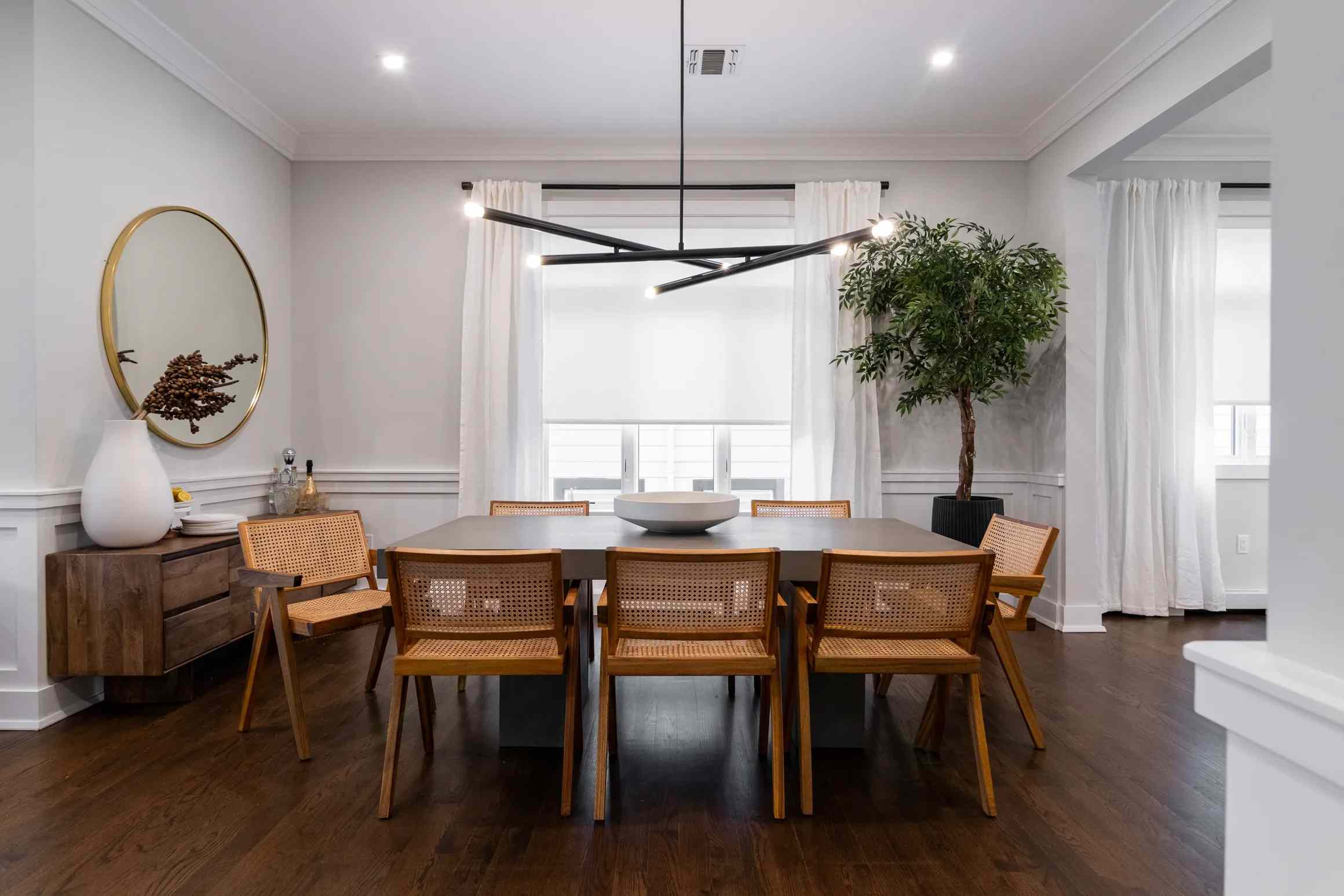 High end dining room with modern light fixture.
