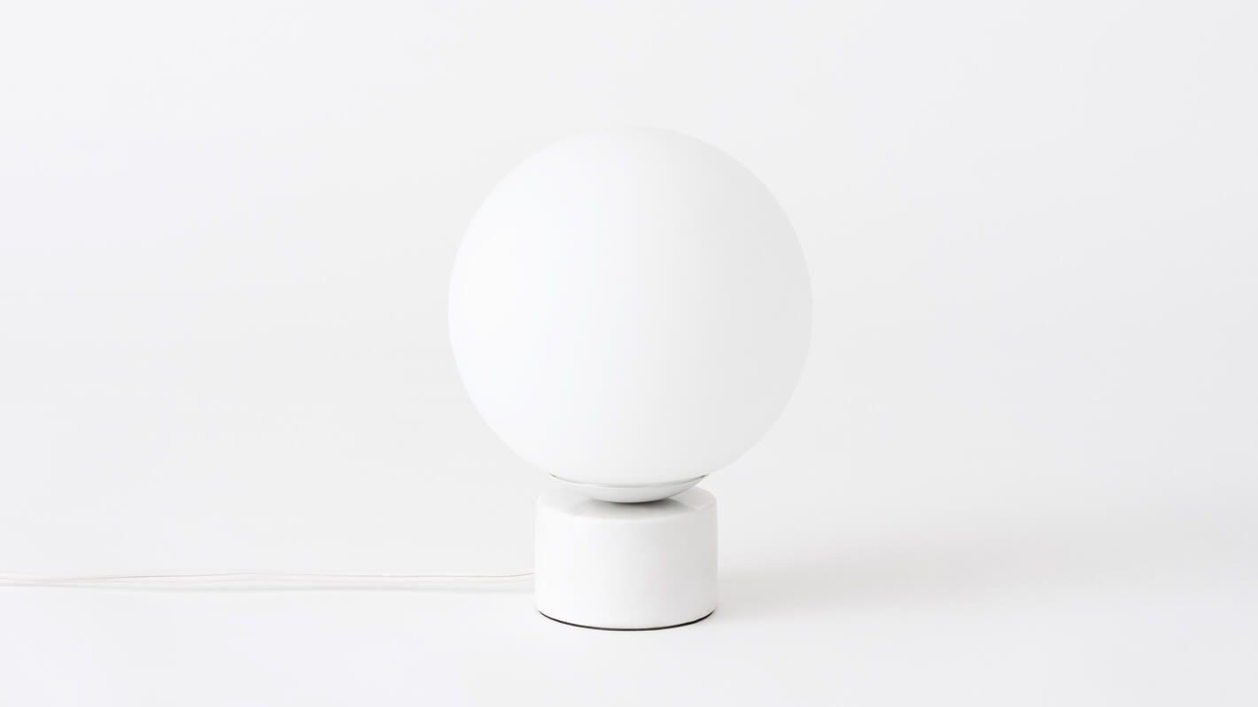 White globe table lamp with white stone base