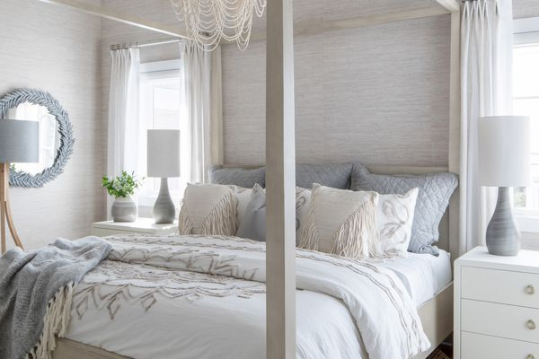 Coastal inspired bedroom with large chandelier.