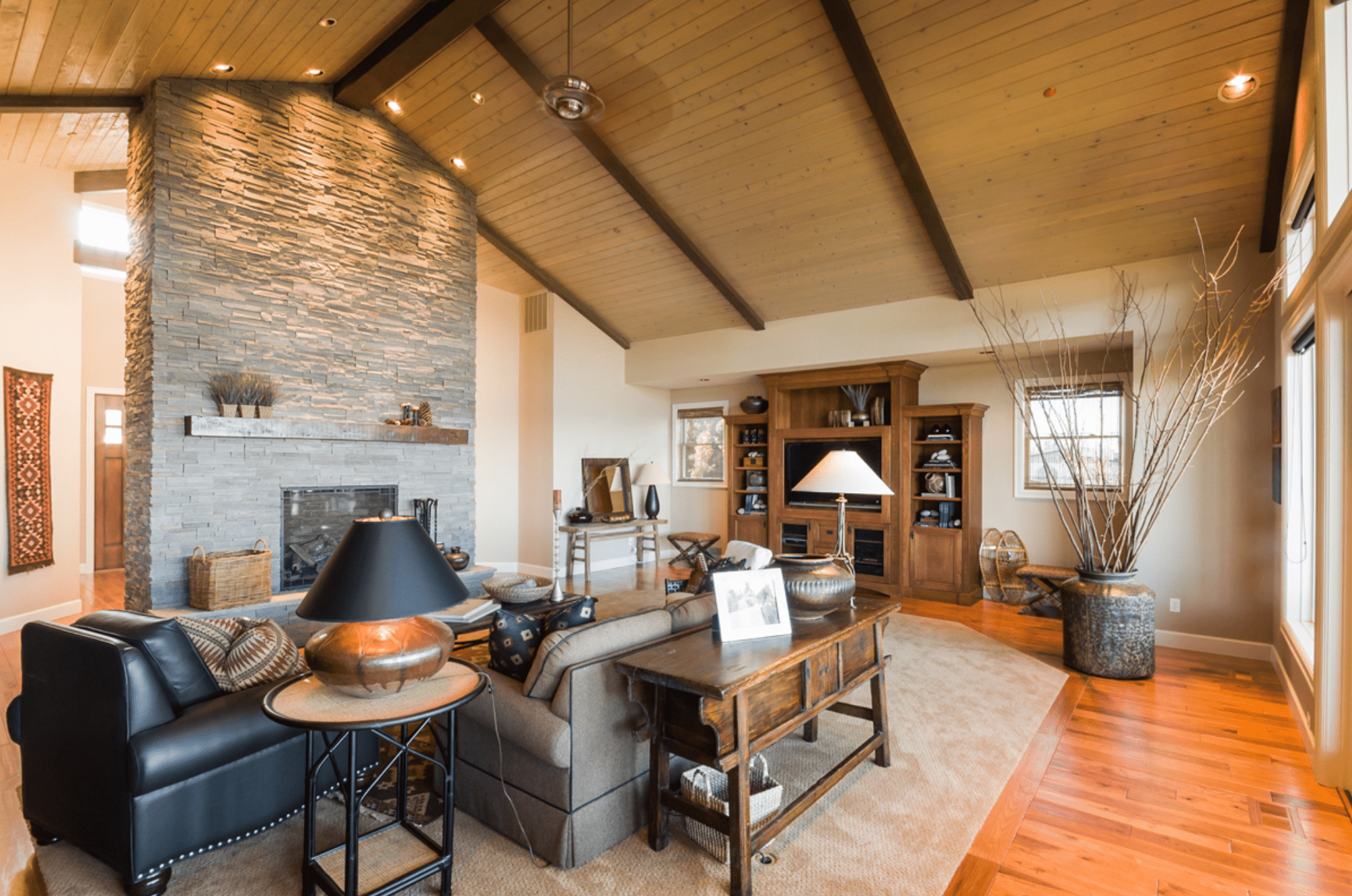 Recessed lights in wooden, A-frame style living room in earthy color palette