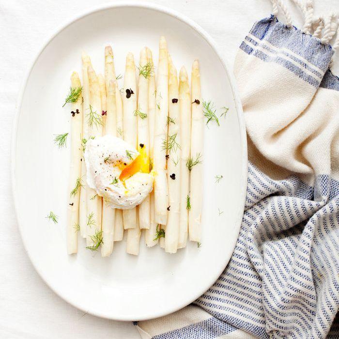 Poached egg over white asparagus
