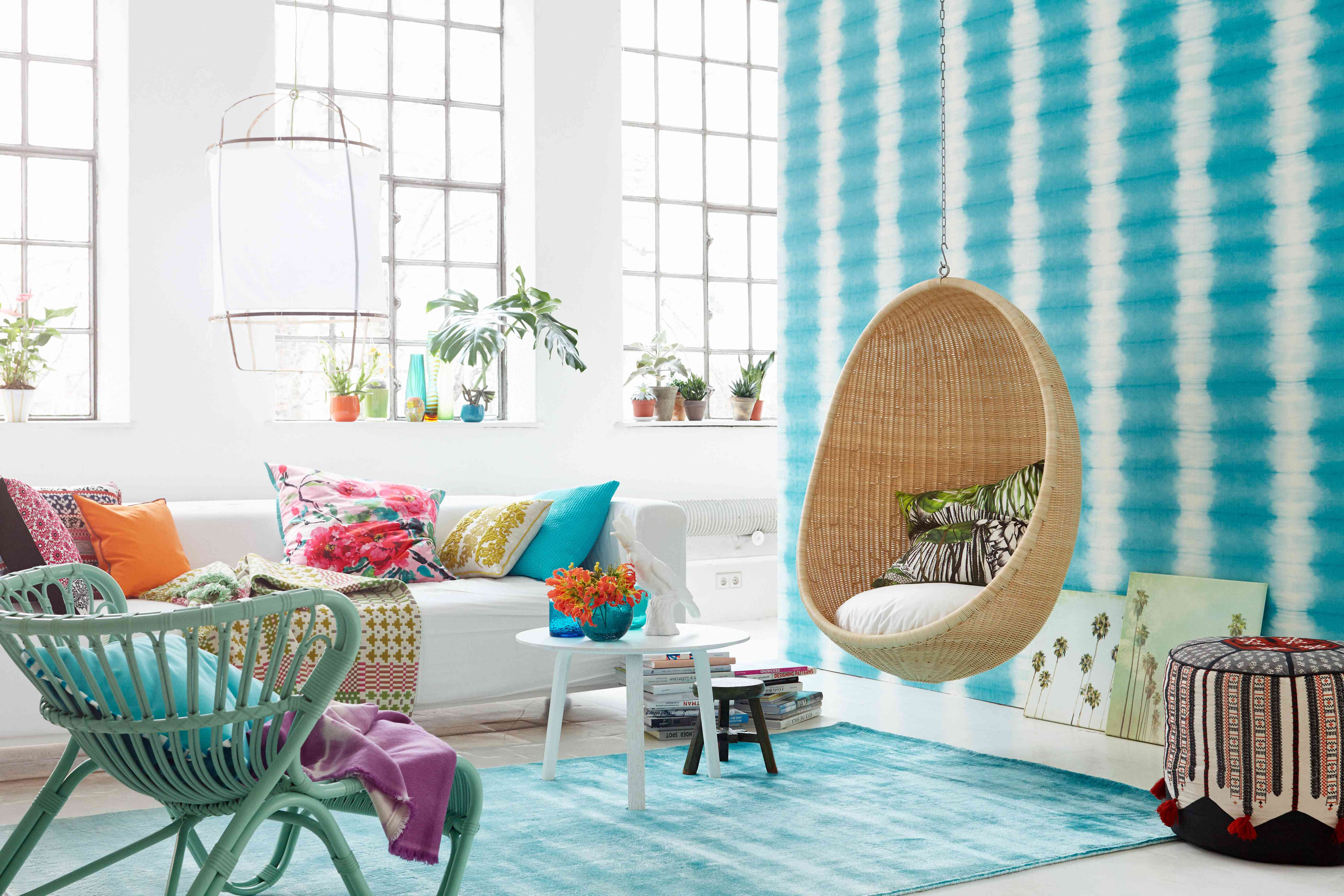 Colorful living room with rattan swing and chair