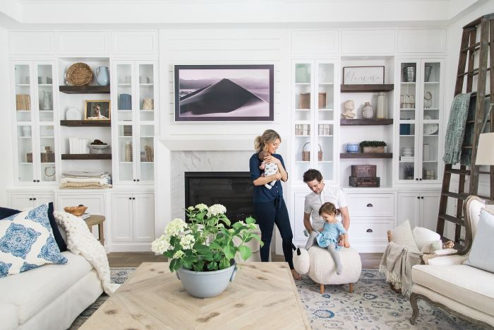 The Manno family's living room features a white couch