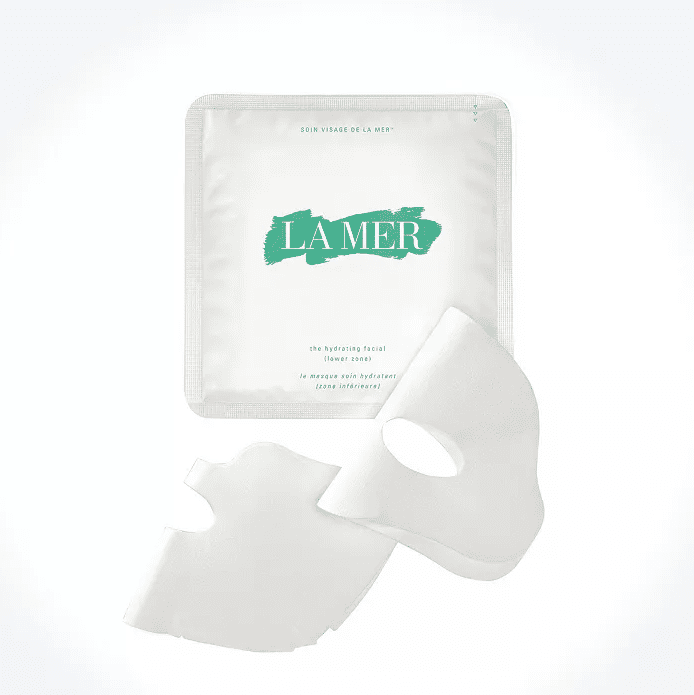 A packet of La Mer sheet masks with green lettering and the La Mer logo.