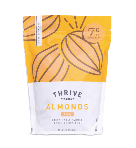 A white and yellow bag full of raw almonds.