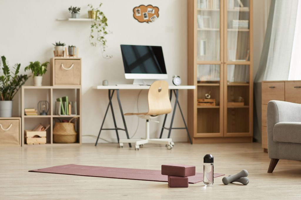 Yoga mat in room with plants