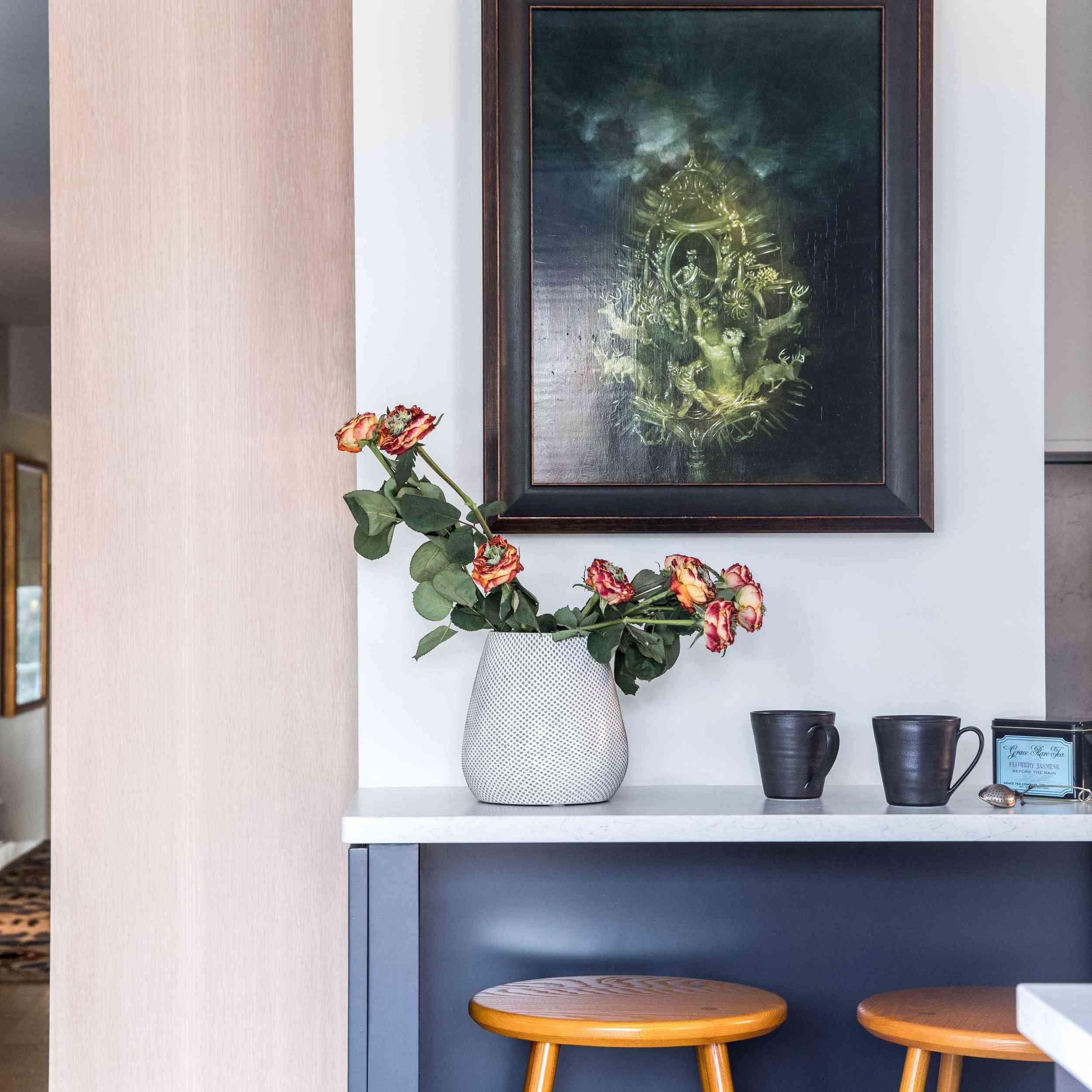A kitchen with an indigo island