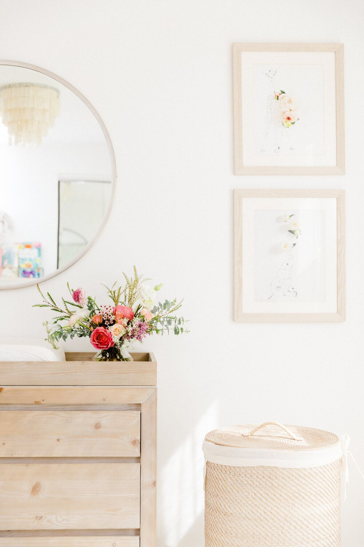 Bright floral arrangement in neutral bedroom.