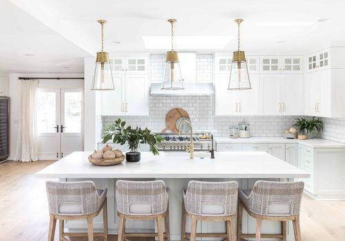 Bright white kitchen with subway tiling.