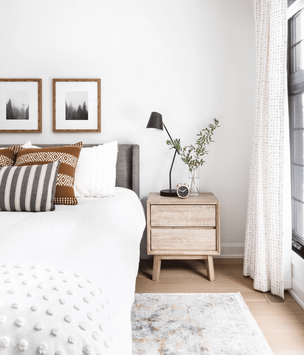 A bedroom with polka dot curtains and a similar bedspread