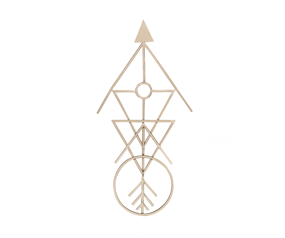 Gold metal wall hanging in the shape of an arrow with other round symbols.