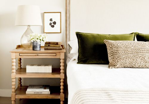 tips for staging your home -deodorize, white bedroom with soft wood accents