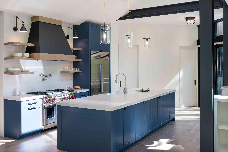 Blue kitchen island with sleek finishes.