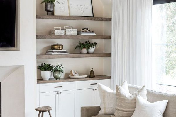 Neutral living room with built-in shelves and decor.