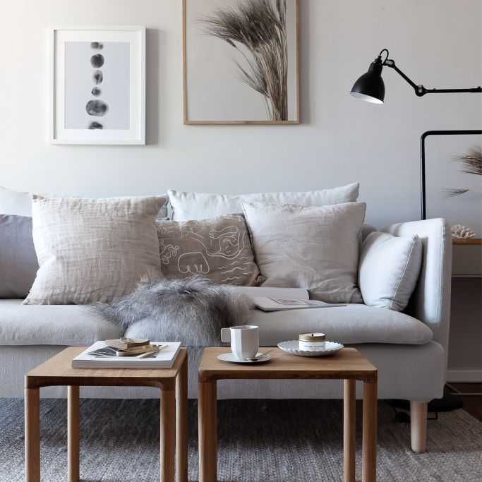Small space living room with a gray sofa and two end tables
