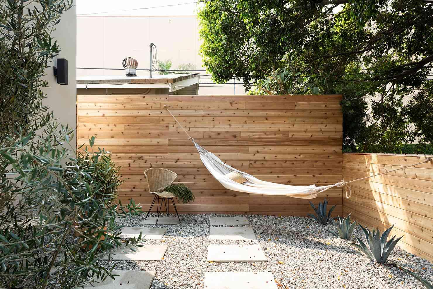 Backyard with natural wood walls
