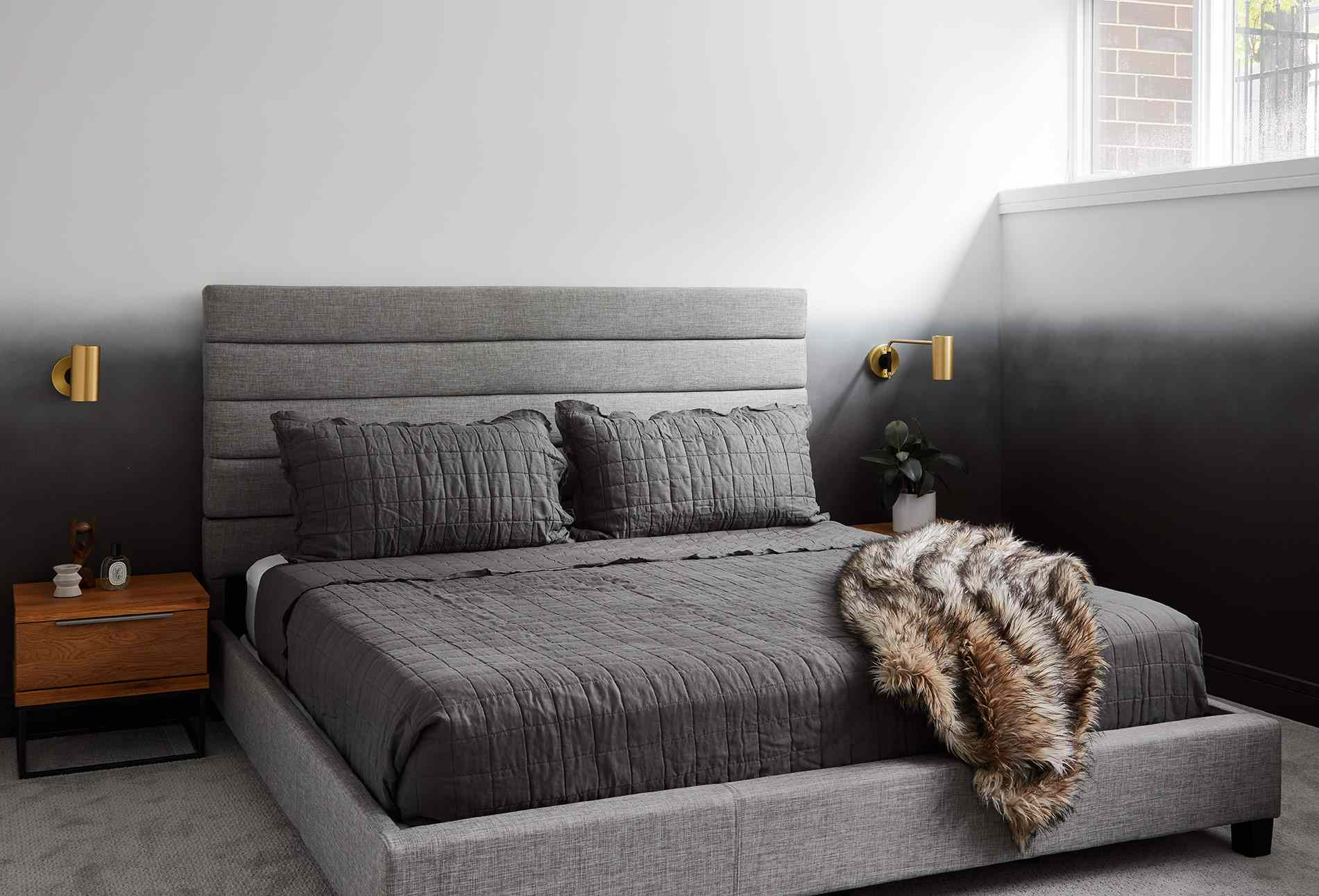 Bedroom with ombre gray walls and gray bedding