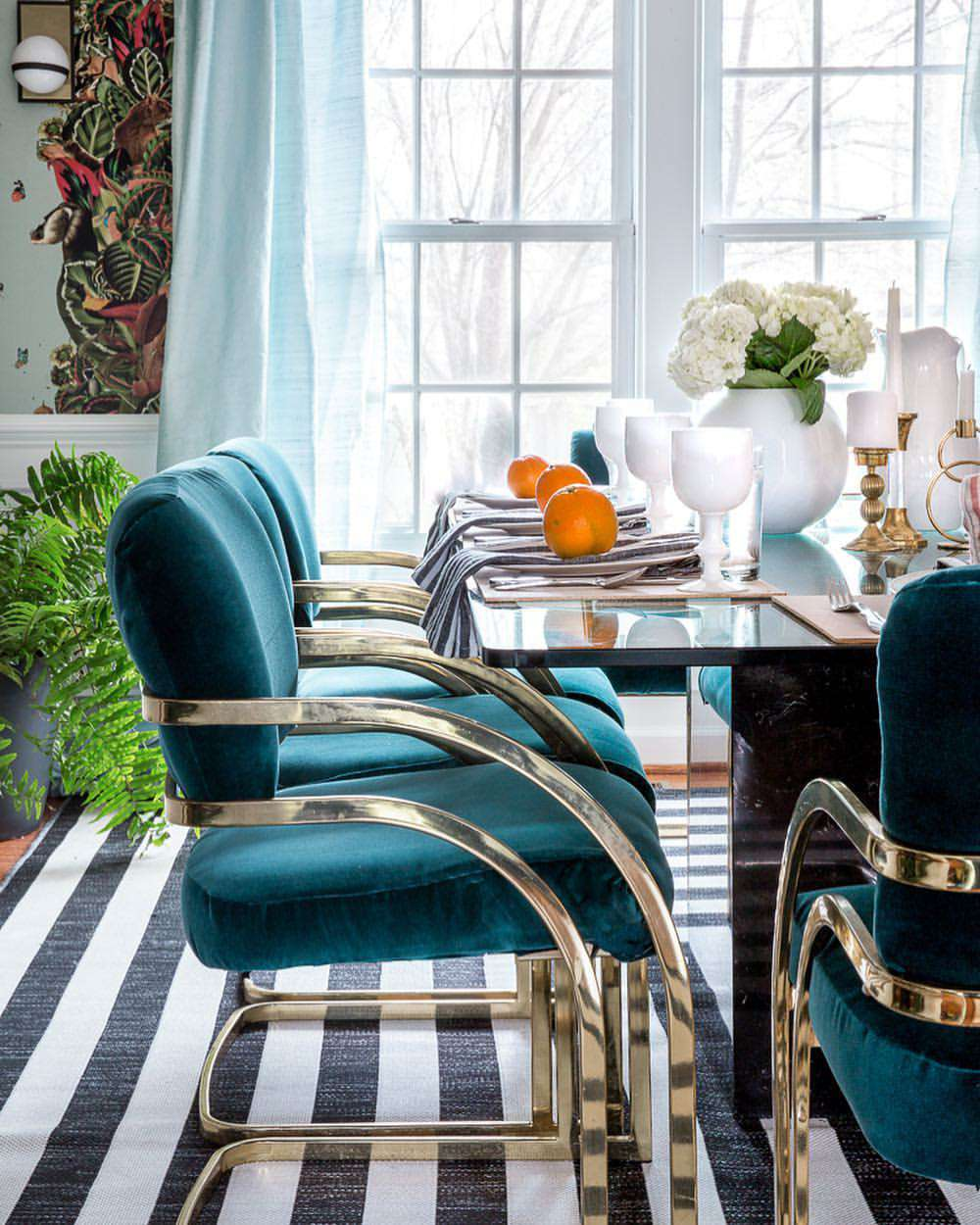Retro dining set with teal velvet chairs.