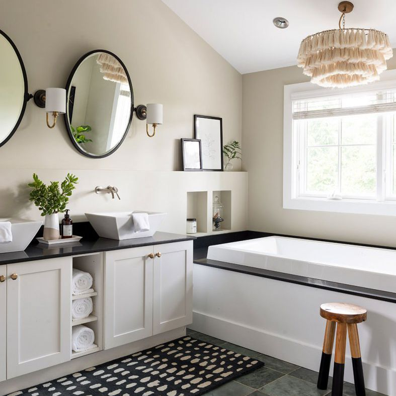 A bathroom with a double vanity equipped with two vessel sinks