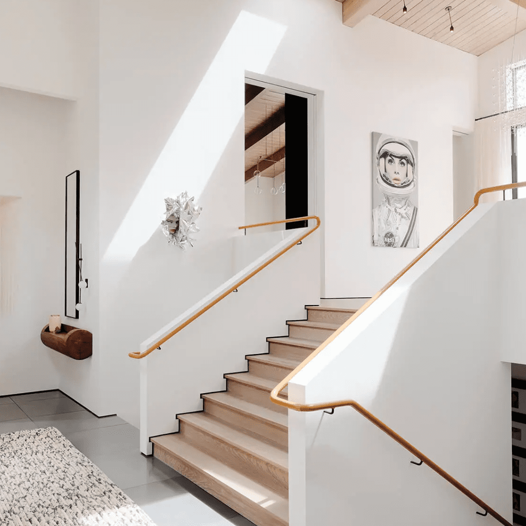 An open staircase adorned with several pieces of modern art