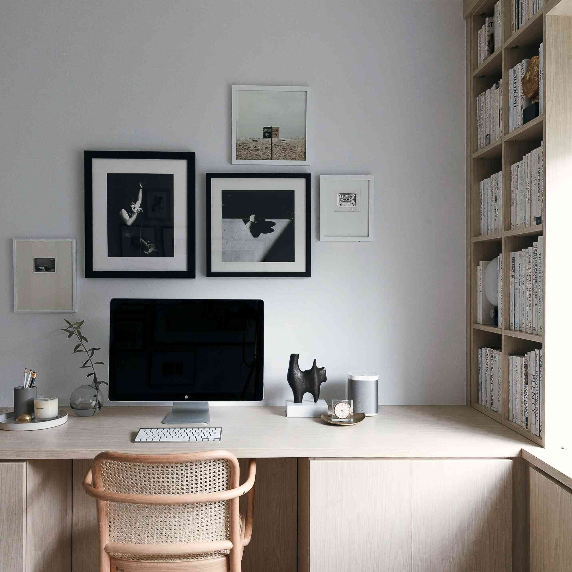 Home office with gallery wall around computer