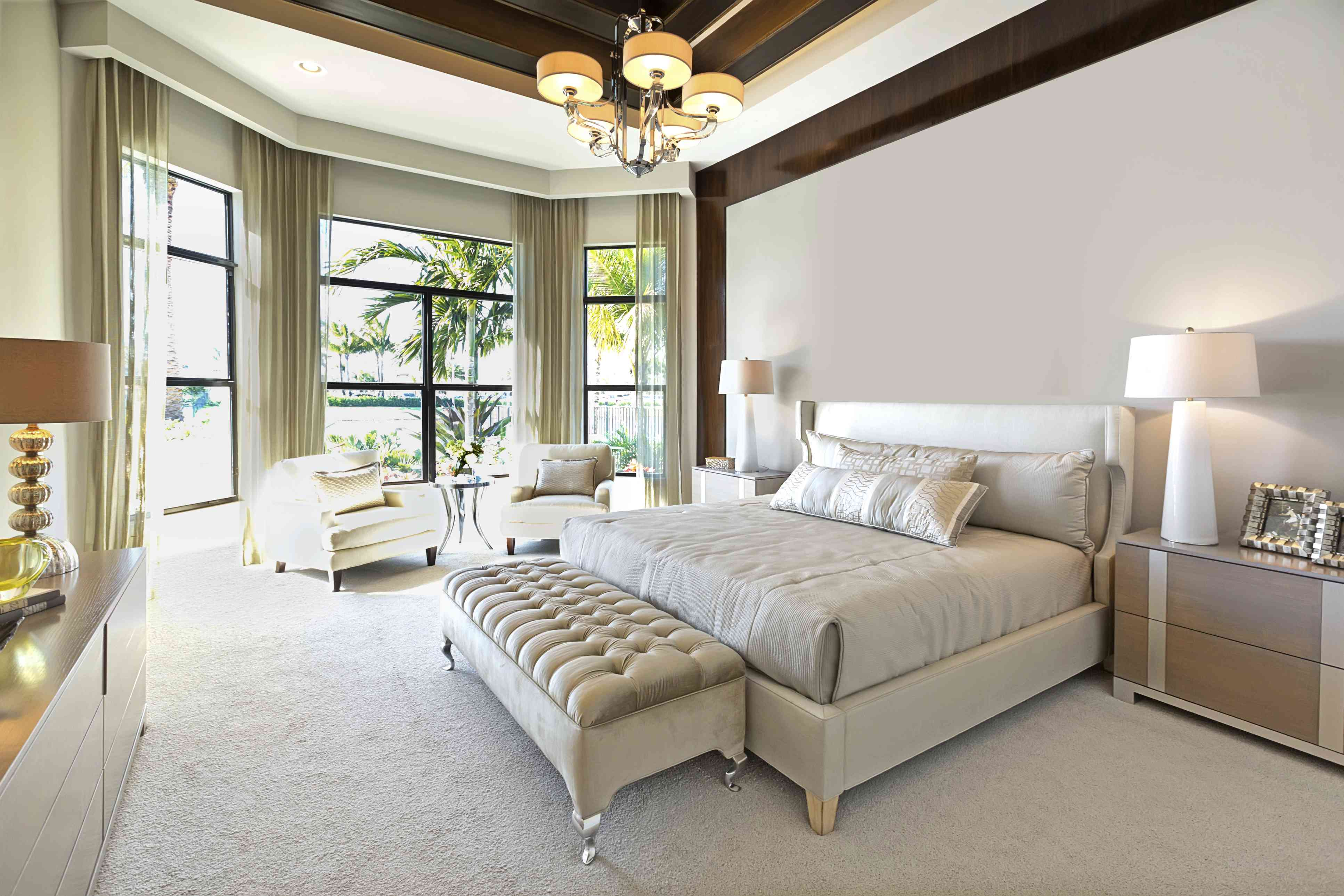 Master bedroom in neutral colors featuring white carpet