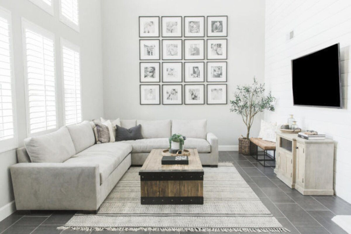 White living room with large gallery wall.