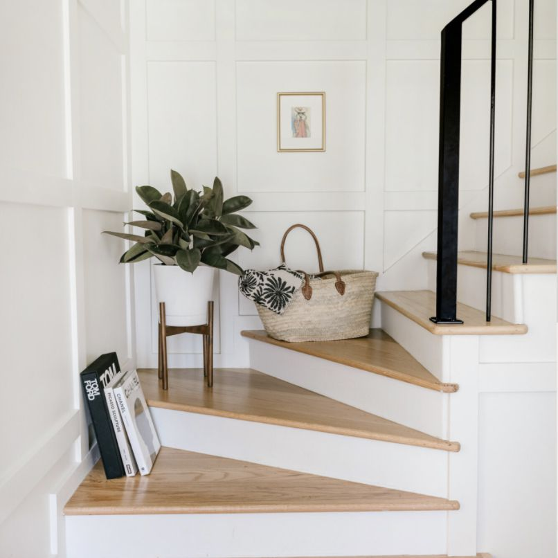 white entryway with stairs used to display decor