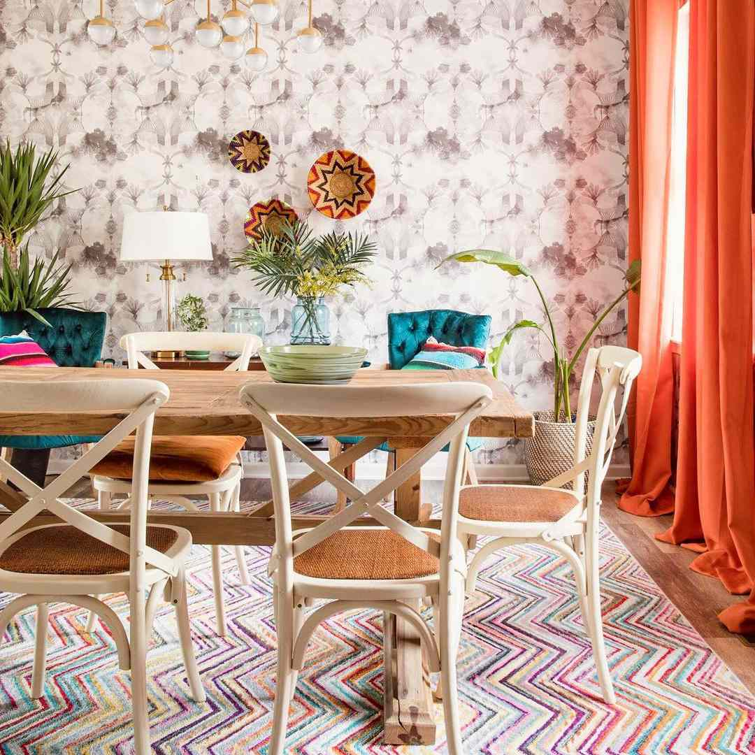 Patterned dining room with colorful rug.