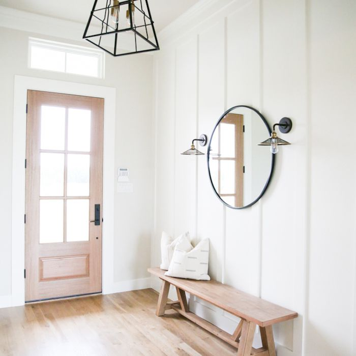 white and wooden minimal entryway
