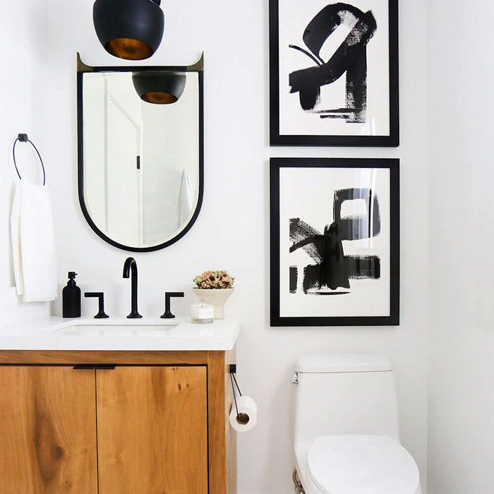 Powder room with white walls