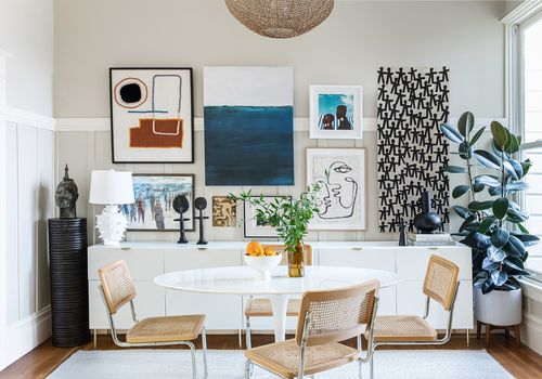 Modern cute dining room with gallery wall.