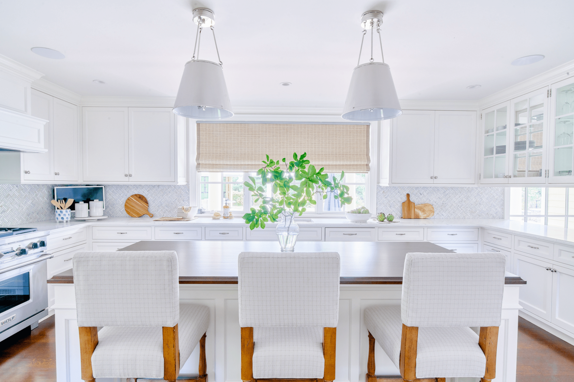 All white kitchen with wood-topped kitchen island