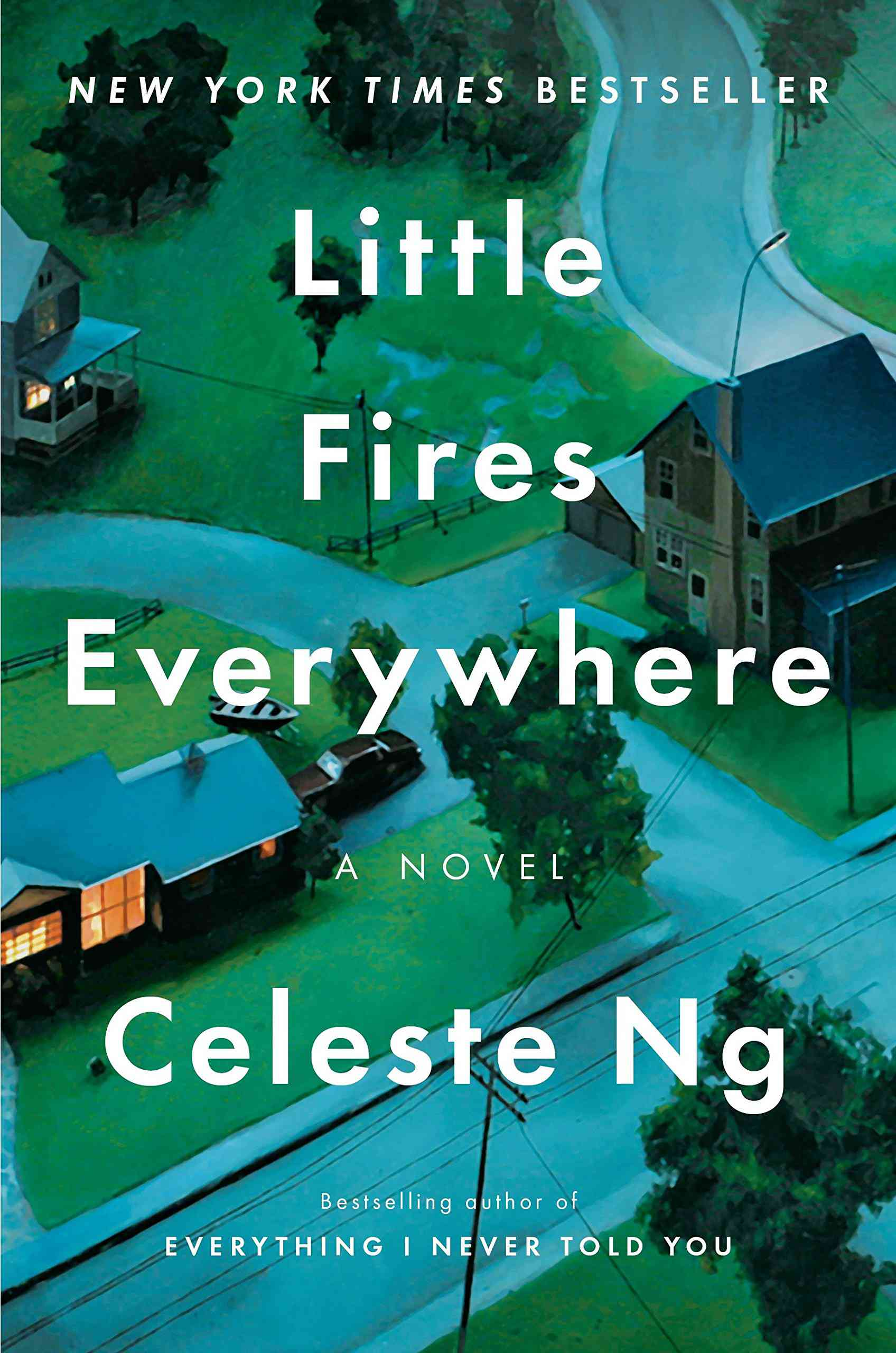 A book cover featuring model homes, entitled Little Fires Everywhere.